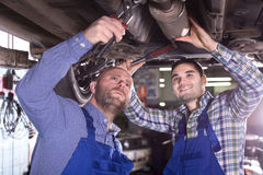 Two people fixing car Royalty Free Stock Photography