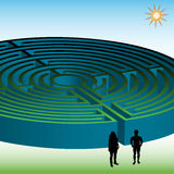 Two people in front of a maze Stock Photos