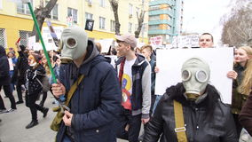 Two people in gas masks go to the rally. People in masks at the demonstration. NOVOSIBIRSK, RUSSIA, MAY 1, 2017: Action Monstration 2017 in Novosibirsk. Two stock video