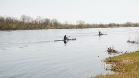 Two people go kayaking down the river. Steadicam shot stock video footage