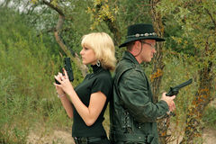 Two people with guns. Duel Stock Images