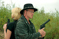 Two people with guns, duel royalty free stock photos
