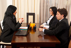 Two people having an interview. Two business people having an interview with a manager woman in a workplace Stock Photo