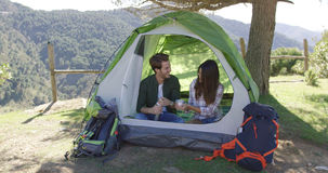 Two people having rest in tent Stock Photos
