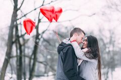 Two People With Heart Shape Balloons in Winter Royalty Free Stock Images
