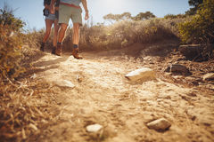Two people hiking along a dirt trail Stock Photography