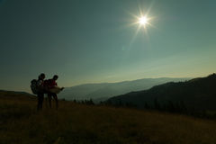 Two people hiking on the mountain Royalty Free Stock Photos