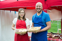 Two people holding baskets of baked goods royalty free stock photos