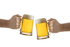 Two people holding a beer glass Royalty Free Stock Image
