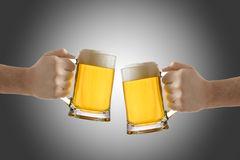 Two people holding a beer glass Stock Images