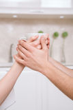 Two people holding cup together Royalty Free Stock Images
