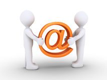 Two people holding e-mail symbol Royalty Free Stock Photo