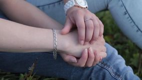 Two people holding hands stock video
