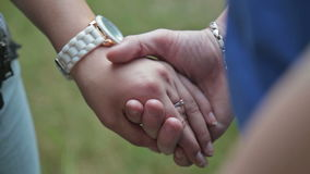 Two people holding hands stock video footage