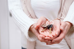 Two people holding keys Stock Photos