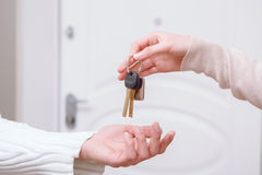 Two people holding keys Stock Photography