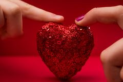 Fingertip on a Sparkling Heart Royalty Free Stock Photo