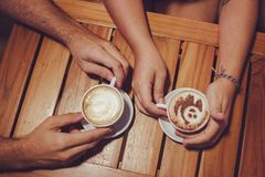 Two People Holding White Cup With Coffee Royalty Free Stock Images