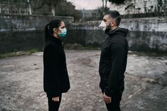 Free Two People In Masks Talking From Distance.Couple Being Divided By Incurable Infectious Disease.Infection Control,isolation. Royalty Free Stock Photography - 176624507