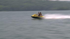 Two people on a Jet Ski stock video