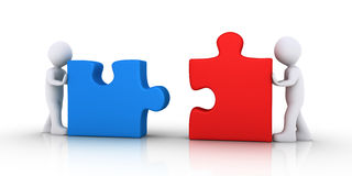 Two people join the puzzle pieces. Two 3d people are pushing puzzle pieces in order to be connected Royalty Free Stock Photography
