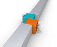 Two people join the wall line Stock Image