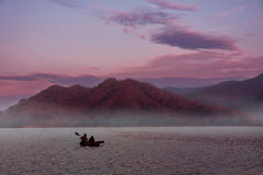 Two People Kayaking on sunset Stock Photography