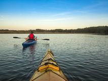 Two people kayaking Royalty Free Stock Photos