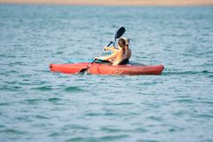 Two people on the kayans on the lake royalty free stock images
