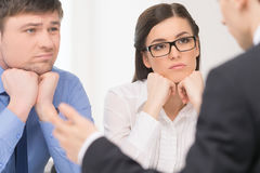 Two people listening to man. Stock Photos