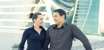 Two people look at each other in the city. Two smiling people look at each other in the city Royalty Free Stock Photos