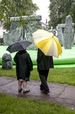 Two people look at the inflatable Stonehenge Royalty Free Stock Images