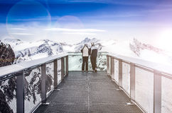 Two people looking at Alps mountains from viewpoint platform Royalty Free Stock Photography