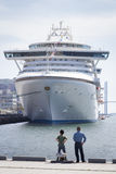 Two People Looking at Cruise Ship, Nagasaki Harbour Stock Photo