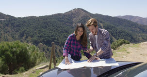 Two people looking at map searching route Royalty Free Stock Images