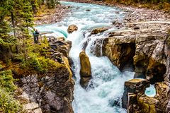 Two people looking at Sunwapta Falls in Jasper National Park Stock Photography