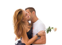 Two people in love kissing and woman holding rose stock photos