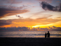 Two people in love at sunset on the beach Stock Photos
