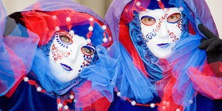 Two people in masks at the Venice Carnival Stock Image