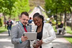 Man and woman looking at tablet screen and smile stock photos