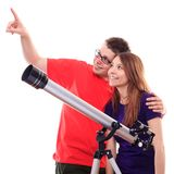 Two people observe through a telescope. Studio shoot Royalty Free Stock Photography