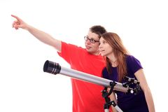 Two people observe through a telescope. Studio shoot Stock Photography