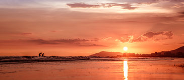 Two people in the ocean. Sunset on the south-china sea, Hainan - tropical island in China Stock Images