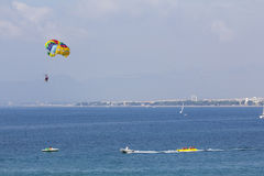 Two people parasailing in the sea at summer Stock Photo
