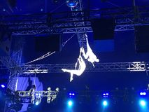 Two people are performing on the circus stage. Circus pro performers playing on the royalty free stock image