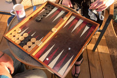 Two people play Backgammon Royalty Free Stock Photo
