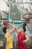 Two people playing basket ball Royalty Free Stock Images