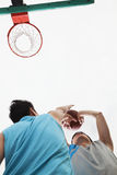 Two people playing basketball, blocking Royalty Free Stock Photography