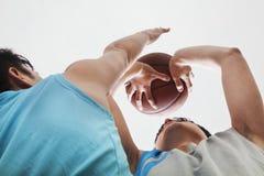 Two people playing basketball, blocking
