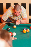 Two people playing billiard Stock Photography